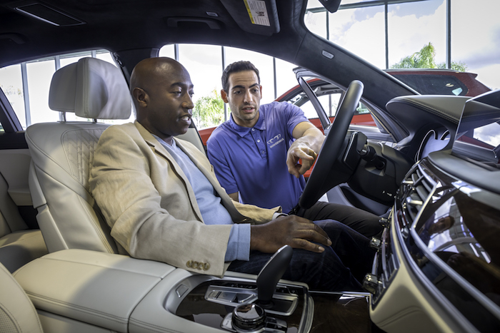 BMW employee showing a car to a customer