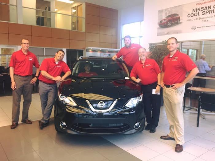 Nissan Of Cool Springs Sales Team In The Showroom