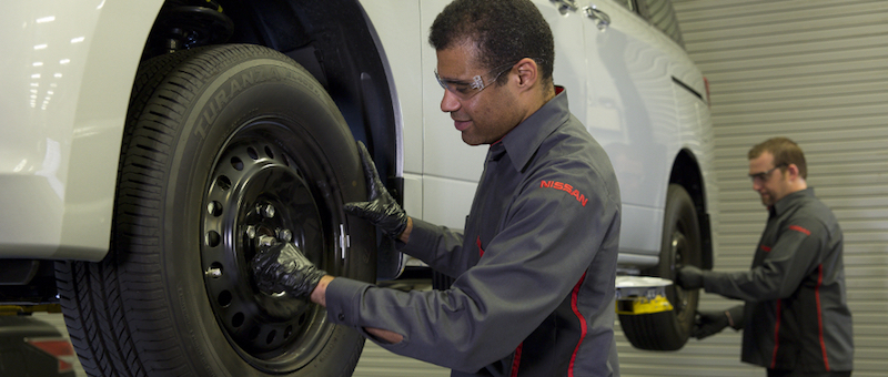 Nissan Of Cool Springs Technician Working On A Tire Rotation